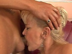 Puffy blonde grandma is fucking with young guy