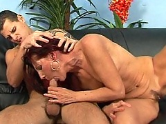 Redhead granny sucking and fucking with young guy